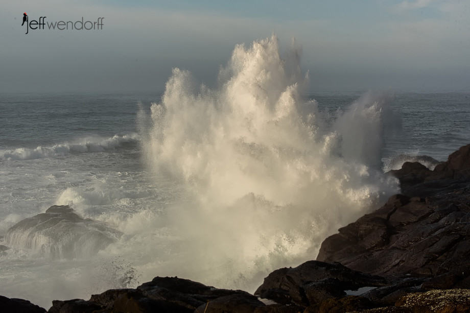a big wave crashing on to the rocks in Boiler Bay on the Oregon Coast by Jeff Wendorff